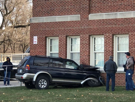 A sport utility vehicle rests after striking the side