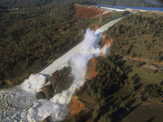 An aerial photo released by the California Department of Water Resources shows the damaged spillway with eroded hillside in Oroville, Calif., on Saturday, Feb. 11, 2017.