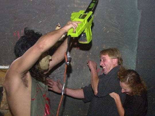 A couple gets a scare out of a chainless chain saw in the Dungeons of Doom haunted house back in the day. It's reopened this year in a new location.
