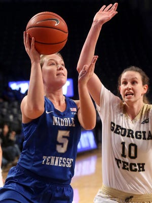 MTSU's Abbey Sissom (5) goes up for a shot as Georgia Tech's Katarina Vuckovic (10) guards her in the 3rd round of the WNIT Tournament on Thursday, March 23, 2017, in Atlanta.