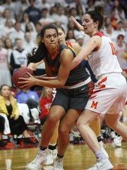 Grinnell senior Sienna Durr tries to get a pass around