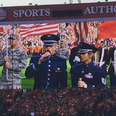 Former Dickson County resident Jamie Teachenor sings the national anthem at Mile High Stadium at halftime of the Denver Broncos game Sunday.