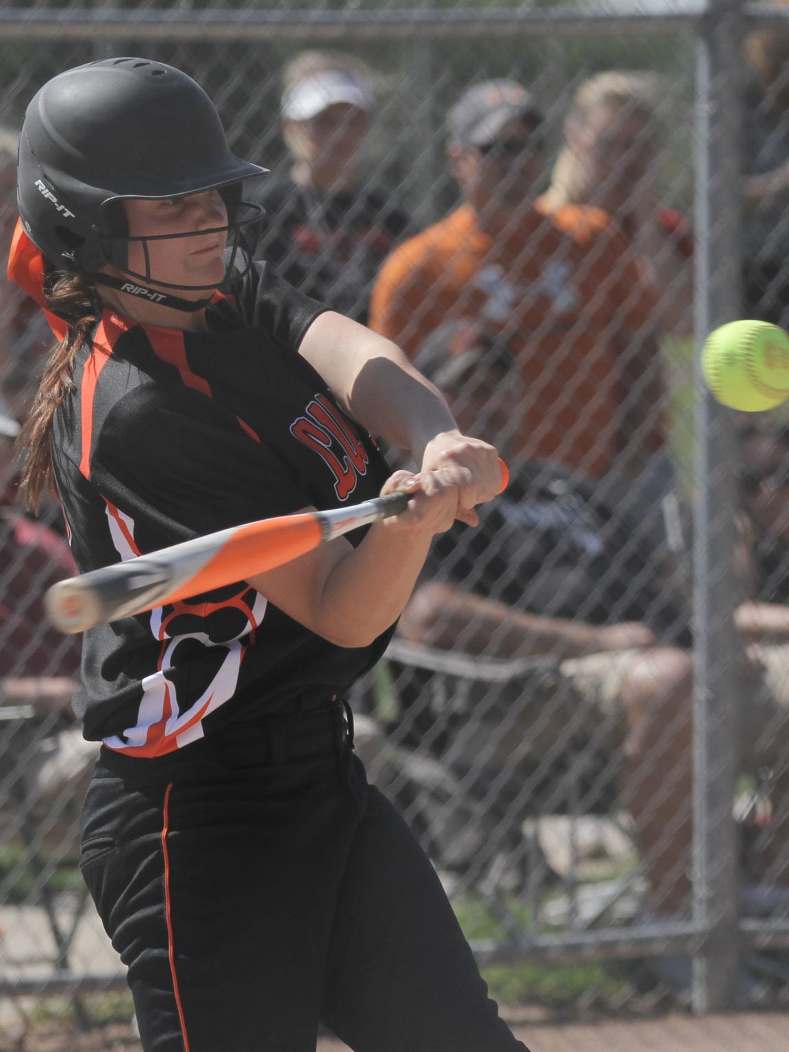 Lucas' Liz Yirga swings at the ball during a district