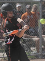Lucas' Liz Yirga swings at the ball during a district final game against Crestline at Shelby High School on Tuesday.