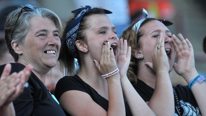 Fans cheer during a performance at the 2013 Wisconsin Valley Fair in Marathon Park in Wausau.