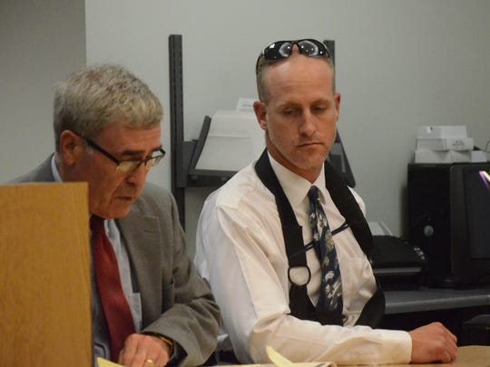 Kyland Hudson, right, with his attorney J. Thomas Schaeffer.