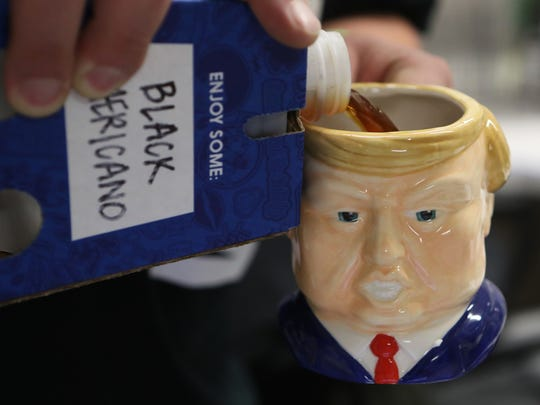 A Trump coffee cup is filled at an inauguration party Friday morning at the chiropractic office of Dr. Maria Salas in Redding.