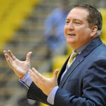 Southern Miss head coach Donnie Tyndall  calls to his players as they take on Truman State.