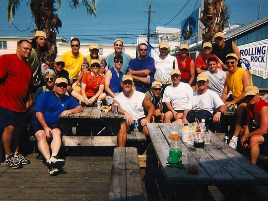 Everybody is happy, and relieved they survived the 100 miles, when they roll into Dewey Beach. A past group included (first row, sitting) Jimmy Flannigan, Jack Hoban, Danille Drupieski, Jim Flannigan Jr., Mark Munzer, Bobby LaFazia, Bill Drupieskli, Dan Thorpe, Matt Ambler, Chuck Rynkowski and John Foster. In the second row are Eric August (from left), Matt August, Billy Waters, John Lentz, Steve Howell, Mark Dixon, Gary Ferenz, John August, unidentified person and Glenn Kemske.