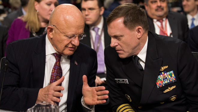 Director of National Intelligence James Clapper Jr. and National Security Agency and Cyber Command Chief Michael Rogers prepare to testify before a Senate Armed Services Committee hearing on Jan. 5, 2017.