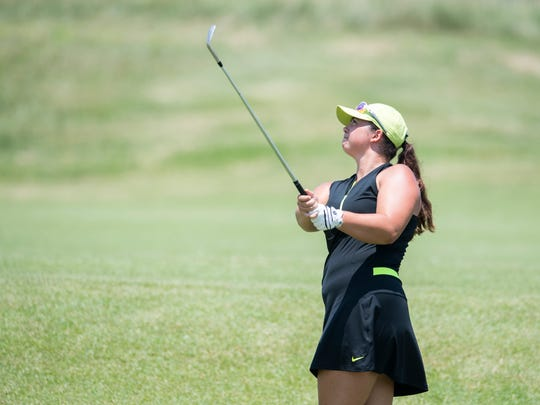 Emma Kieffer chips the ball towards the green during the final round of the Women's City golf tournament at Cambridge Golf Course on Sunday, July 1, 2018.