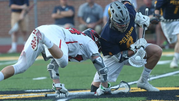 From right, Pelham's Quinlan Crowley (9) controls a