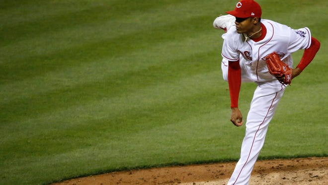 Cincinnati Reds relief pitcher Raisel Iglesias (26) delivers in the ninth inning.