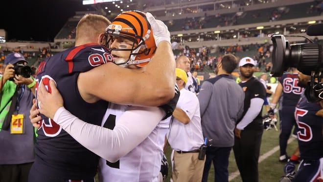 Cincinnati Bengals quarterback Andy Dalton (14) and Houston Texans defensive end J.J. Watt (99) embrace at the end of the game  between the Houston Texans and the Cincinnati Bengals, Thursday, Sept. 14, 2017, at Paul Brown Stadium in Cincinnati.