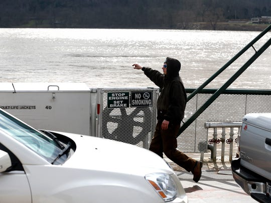 Brandon Ingram of Hebron, directs cars on the Anderson Ferry before crossing the Ohio River to Cincinnati Thursday March 2, 2017. The Anderson Ferry, which is on the National Register of Historic Places, celebrates its 200th anniversary this month.