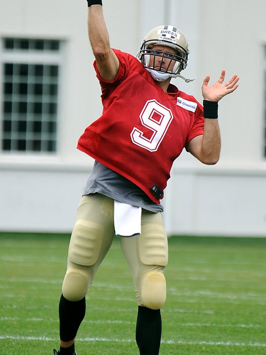 New Orleans Saints quarterback Drew Brees (9) throws a pass during the teams NFL football training camp in White Sulphur Springs, W.Va., Friday, Aug. 1, 2014. (AP Photo/Chris Tilley)