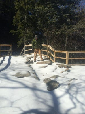 Snow and ice covers trails and walkways in Chimney Rock Park.