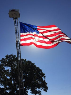 A flag flies above the VFW Post 1848 during the post's 17th annual reunion Oct. 19 in Jackson.