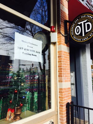 """The Old Town Distilling Co. closed its site on Linden Street. A sign on the window reads """"Merry Christmas from The Poudre Keg coming soon."""""""