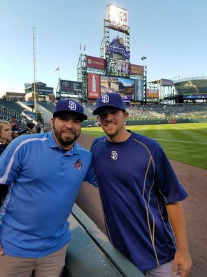 St. Cloud Rox Manager Augie Rodriguez, left, had the chance to reunite with current San Diego Padres reliever Jake Smith in Denver this past weekend when the Padres took on the Colorado Rockies.