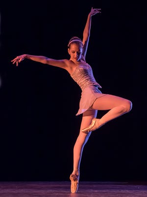 """Catherine Cobb dances during a performance of ADT's """"The Princess Stories and More."""""""