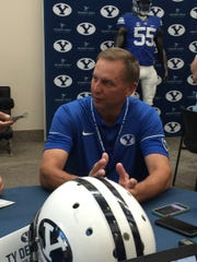 BYU offensive coordinator Ty Detmer talks with reporters