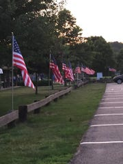 American flags line the perimeter of the RVA Fields in Boonton Township, which is celebrating its 150th anniversary with a festival on Sat. July 15, 2017.