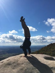 Todd Allen does a handstand while hiking in the Cumberland