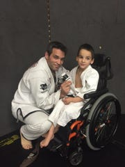 Brett Welcome is the co-owner of Springfield Fight Club. His son Nino is shown in his orange-and-black wheelchair.