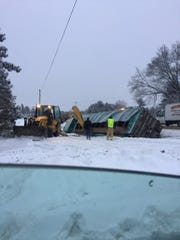 No injuries were reported after a crash between a tractor trailer and a snow plow truck caused the shutdown of Route 221 for three hours.