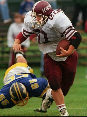 Greece Arcadia's Joe Meisenzahl gets past the tackle attempt of Irondequoit's Joe Rizzo on Oct. 1, 1994.