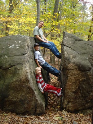 New York's draft Open Space Conservation Plan High Tor addresses the need to preserve the Palisades Ridge and Rockland Highlands by securing sections of steeply sloping talus and woodlands adjacent to High Tor State Park. In 2010, Jim Gifford with sons Shawn, center, and Ryan hike Hi Tor, near Haverstraw.