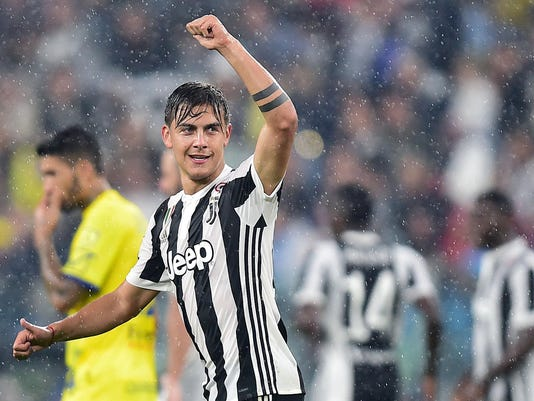 Juventus forward Paulo Dybala celebrates after scoring a goal during the Italian Serie A Soccer match between Juventus and Chievo at the Allianz Stadium in Turin, Italy, Saturday, Sept. 9, 2017. (Alessandro Di Marco/ANSA via AP)