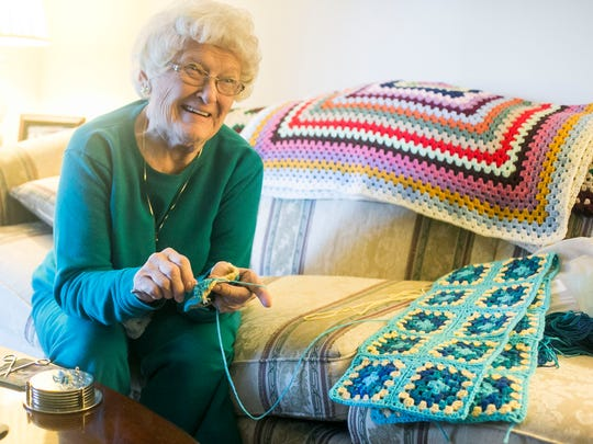 Janet Clark, of Dover Township, smiles while crocheting an afghan square for a new throw Wednesday, Nov. 23, 2016. Clark, who has been crocheting since the 1960s, will soon donate 30 afghans she made to the Walter Reed National Military Medical Center in Bethesda, Maryland. Amanda J. Cain photo
