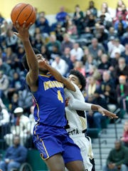 Irondequoit's Gerald Drumgoole attacks the basket on Dec. 29.