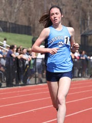 Sarah Flynn from The Ursuline School, runs the girls Covert mile during the Ossining relays at the Anne M. Dorner Middle School in Ossining, April 14, 2018.