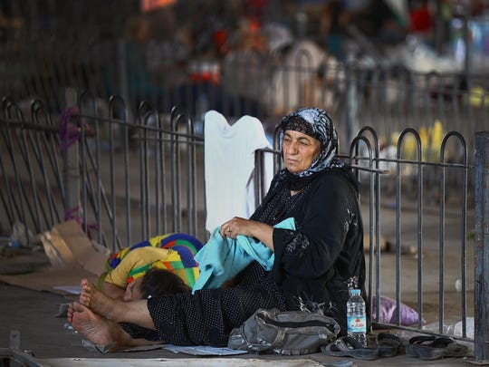 An Iraqi refugee, of those who fled from Mosul and other towns, sits at a temporary camp outside Irbil, northern Iraq, July 9, 2014, nearly a month after Islamic militants took over the country's second largest city.