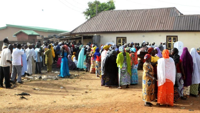Long lines of voters queue outside a polling station in Bauchi, Nigeria.