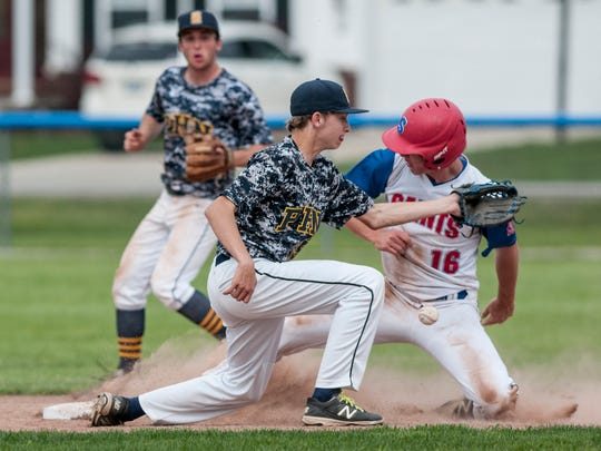 St. Clair's Collin Agosta slides safely into second on Port Huron Northern's Chase Moeller during a baseball game Wednesday, May 17, 2017 at St. Clair High School.