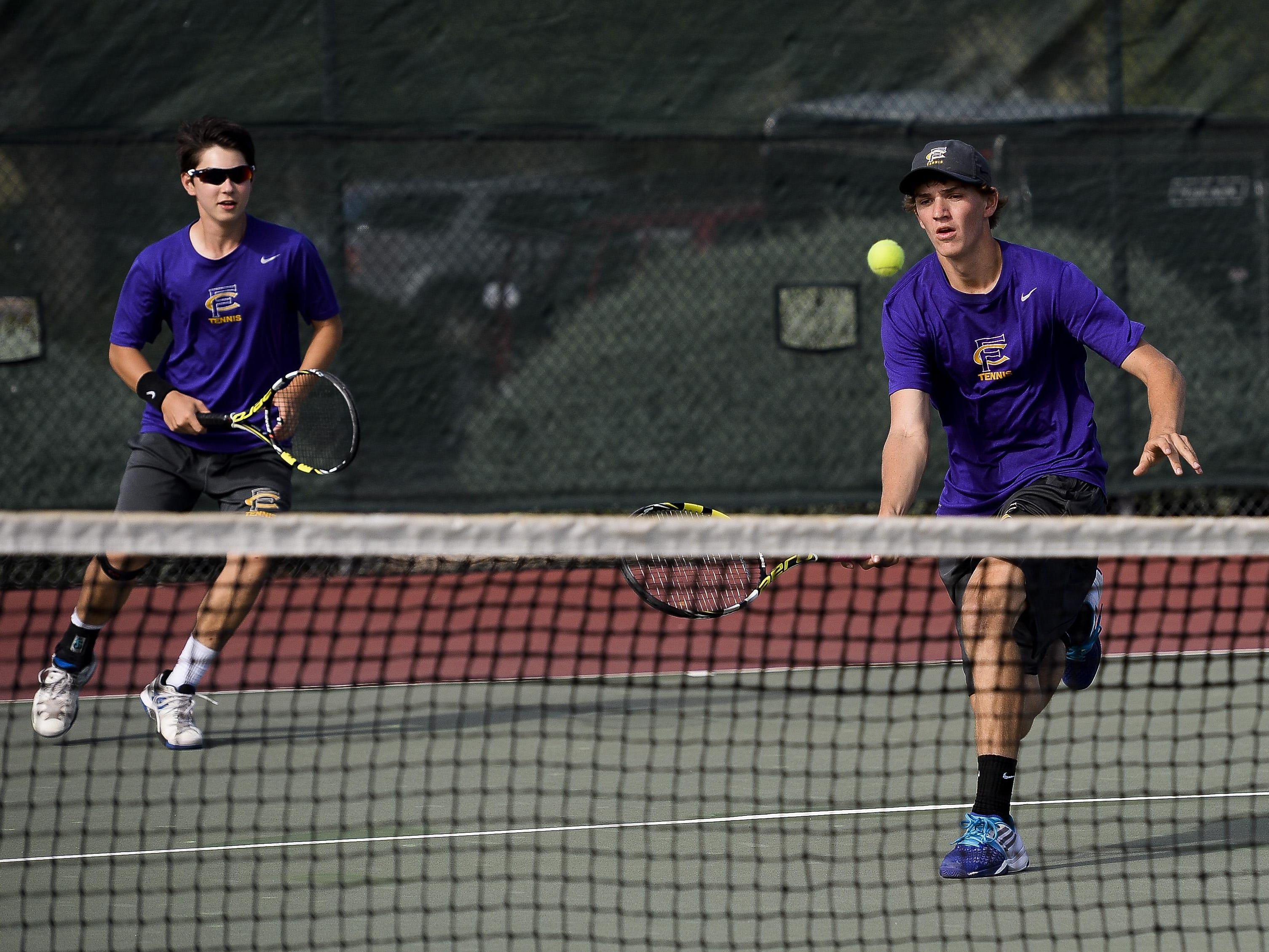 Fort Collins High School's No. 1 doubles tennis team of Trae Beneck, left, and Mitch Carlson play earlier this season. The duo qualified for the state tournament on Wednesday.