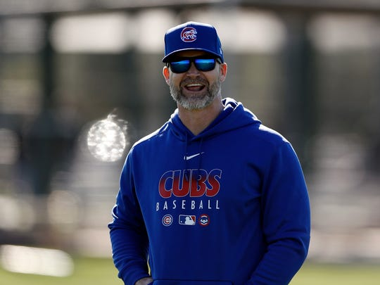 Chicago Cubs manager David Ross laughs during a spring training baseball workout Wednesday, Feb. 12, 2020, in Mesa, Ariz. (AP Photo/Gregory Bull)