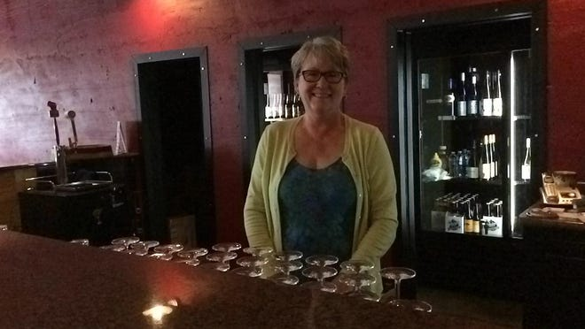 Karen Haferman, owner of Karen's Wines and Steins, behind the bar at her new location at 160 First St. N. The Wisconsin Rapids Area Convention & Visitors Bureau, which is in the same downtown building, is accessed from the Second Street North.