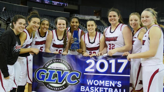 Drury women's basketball team with the championship banner and trophy. The GLVC title is the fourth in Lady Panther history and the second in the three-year tenure of head coach Molly Miller.