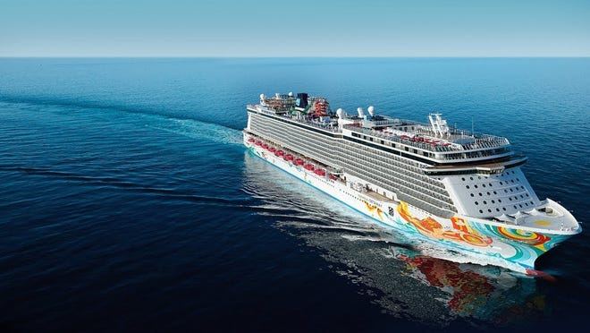 Cruise ship with colorful designs painted on side, making a right turn on a calm sea.