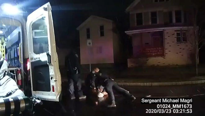 Rochester police body camera footage of police interaction with Daniel Prude on March 23, 2020. Prude became agitated after being hooded eventually a couple of officers held his face sideways against the street.