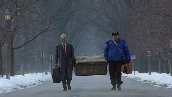 "Steve Martin, left, and John Candy go on a holiday odyssey in the 1997 comedy ""Planes, Trains, and Automobiles."""