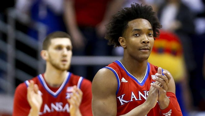 """Former Kansas basketball stars Devonte' Graham, right, and Svi Mykhailiuk, left, will participate in the Rock Chalk Roundball Classic's """"Shooting for the Stars"""" 3-point competition at 7 p.m. Friday. The annual fundraiser for local families battling pediatric cancer has shifted to a remote format this year."""
