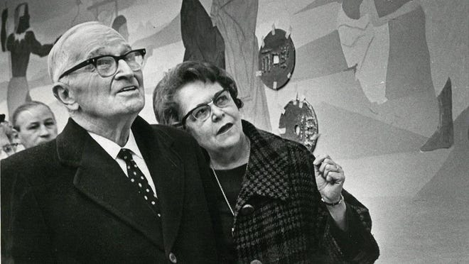 Former President Harry S. Truman tours the new Capital City State Bank on the arm of U.S. Treasurer Georgia Neese Gray.