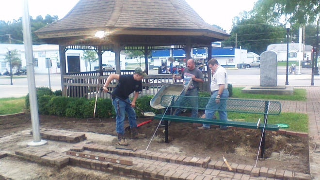 Members of Boy Scout Troop 69 work next door to the Yorktown American Legion.