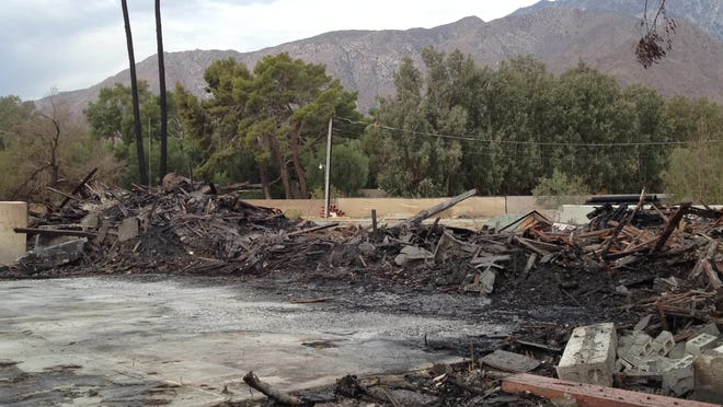 A vacant lot is all that remains of a building destroyed Wednesday night at the Racquet Club in Palm Springs.